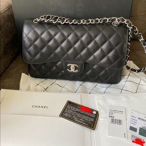 Authentic Chanel black caviar jumbo flap bag